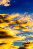 Sunrise clouds blue sky Stock Image