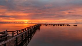 Sunrise at Merritt Island, Florida. Sunrise with clouds and dock at Banana River, Merritt Island, Florida, USA royalty free stock images