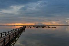 Sunrise at Merritt Island, Florida. Sunrise with clouds and dock at Banana River, Merritt Island, Florida, USA stock images