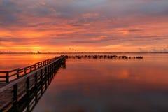 Sunrise at Merritt Island, Florida. Sunrise with clouds and dock at Banana River, Merritt Island, Florida, USA stock image