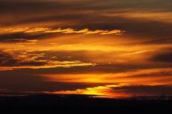 Before the Sunrise. Clouds glow warmly just before the sun comes up Stock Images