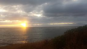 Sunrise in the clouds. Kapaa Kauai bike path Royalty Free Stock Image