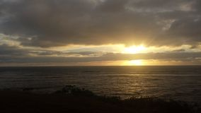 Sunrise in the clouds. Kapaa Kauai bike path Stock Image