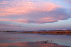 Sunrise Clouds over a Colorado Lake. With the front range and the Indian Peak Wilderness in the distance stock photo