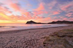 Sunrise clouds over Mediterranean coastline royalty free stock photography