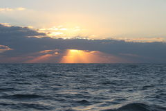 The sunrise. With the clouds at sea Stock Image