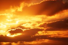Sunrise Cloudscape. A glorious red-gold sunrise on a cloudy morning stock images