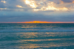 Sunrise on a cloudy day in Miami Beach, Florida. Stock Images