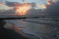 Cloudy sunrise Folly Beach South Carolina stock images