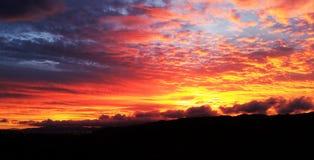 Sunrise through cloudy skies