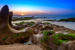 Sunrise on Co Thach beach in Vietnam. BINH THUAN- VIETNAM: Sunrise over beach in Co Thach, Binh Thuan province, Vietnam.With exotic rock formations, Co Thach is Stock Images