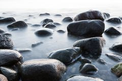 Wet stones by the sea stock image