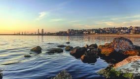 Sunrise on the coast of the Caspian sea. Beautiful scenery. Wonderful water stock photography