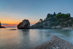 Sunrise at the coast of Taormina Stock Photo