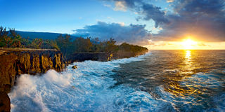 Sunrise on coastline Stock Images