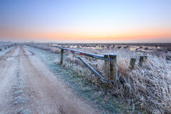 Sunrise on a cold winter day of a rural landscape Royalty Free Stock Photo