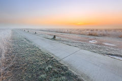 Sunrise on a cold winter day of a rural landscape Stock Photo
