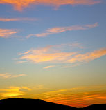 The sunrise in  colored sky white soft clouds and abstract backg Stock Photo