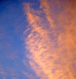 sunrise in the colored sky white soft clouds and abstract backgr Royalty Free Stock Photos
