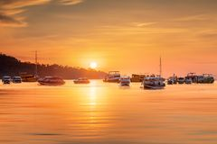 Sunrise with colorful sky and boats on the beach Royalty Free Stock Photos