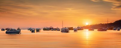 Sunrise with colorful sky and boats on the beach Stock Photo
