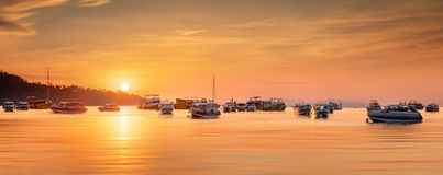 Sunrise with colorful sky and boats on the beach Stock Photography