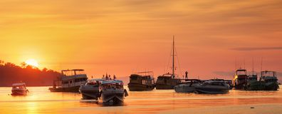 Sunrise with colorful sky and boats Stock Images
