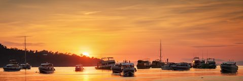 Sunrise with colorful sky and boats Stock Photo