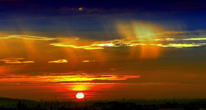 Sunrise. Colorfull sunrise with cityscape blue red yellow Royalty Free Stock Image