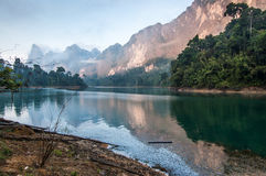 Sunrise Colors On Lake, Khao Sok National Park. Sunrise over Cheow Lan Lake, Khao Sok National Park in southern Thailand Royalty Free Stock Image