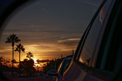 Sunrise Commute. Sunrise in sideview mirror during morning commute Royalty Free Stock Images