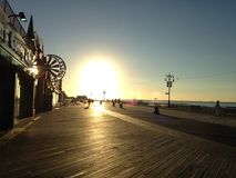 Sunrise on Coney Island Boardwalk. Stock Photos