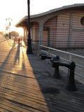 Sunrise on Coney Island Boardwalk. Stock Photo
