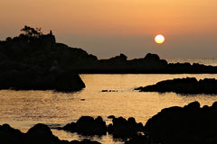 Sunrise at Corsica. Rocky beach at sunrise on East bank of Corsica, near to Favone Stock Photo