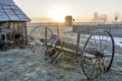Sunrise on a country farm and equipment Royalty Free Stock Photos