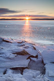 Sunrise and cracked ice at a frozen lake Royalty Free Stock Photography