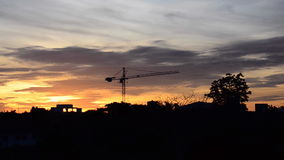 Sunrise with crane construction in dawn. HD stock video