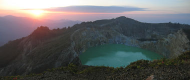 Sunrise on the crater lake. Kelimutu volcano - Flores - Indonesia - Panorama Stock Photography