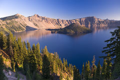 Sunrise at Crater Lake Volcano in Oregon. With Wizard Island at the center royalty free stock image