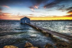 Sunrise at the Crawly Boat shed. A fabulous sunrise looking at the Crawly Boat Shed in Perth, Australia stock photography