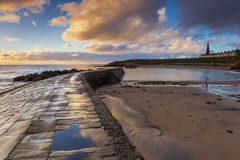 Sunrise at Cullercoats Bay. Royalty Free Stock Photography