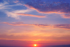 Sunrise and cumulus clouds Royalty Free Stock Image
