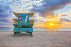 Sunrise with cute lifeguard tower Royalty Free Stock Photos