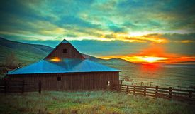 Sunrise On Dalles MT. The Sun rising at Dalles Mt Ranch behind this old barn was a beautiful site Stock Images