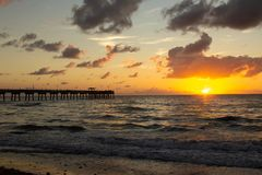 Sunrise on Dania Beach pier, Florida royalty free stock images