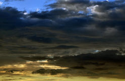 Sunrise and dark clouds Royalty Free Stock Photography