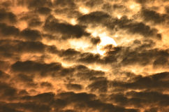 Sunrise and dark clouds Royalty Free Stock Photos
