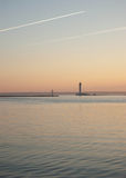Sunrise by the dark sea Stock Images