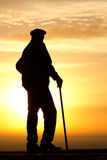 Sunrise  dawn   old  man   silhouette Royalty Free Stock Image