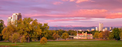Sunrise on Denvers City Park at sunrise on a fall day. Gorgeous sunrise on Denvers City Park. leaves are starting to turn in this autumn season. Fresh snow on Mt stock image